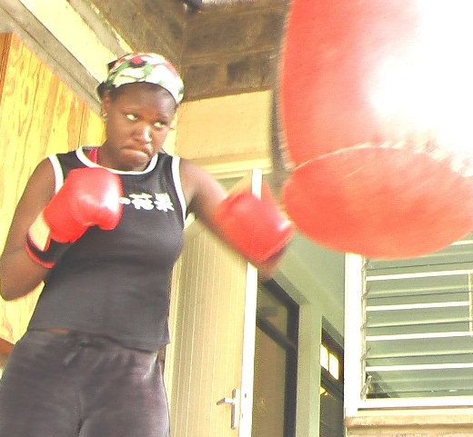 thumb_BG Kenya_woman boxing punching bag