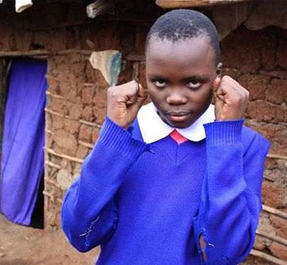 thumb_bg kenya girl in school uniform boxer fists_IMG_2847