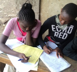 thumb_bg kenya girls homework writingDSC03643